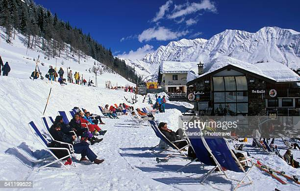 people relaxing near plan checrouit at courmayeur ski resort - クールマイヨール ストックフォトと画像