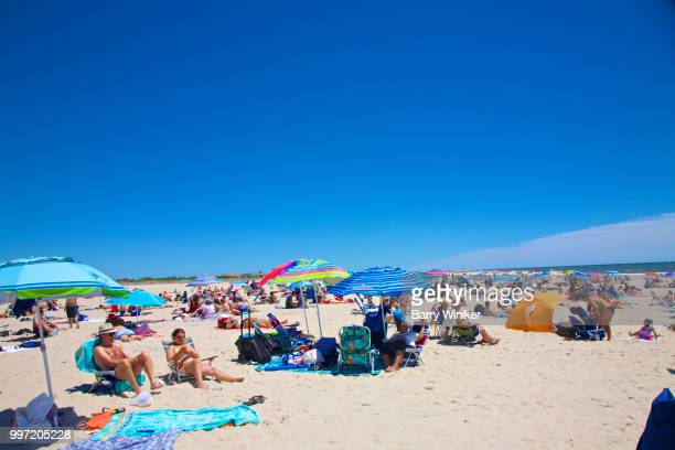 people relaxing near water at jones beach, ny - wantagh stock pictures, royalty-free photos & images