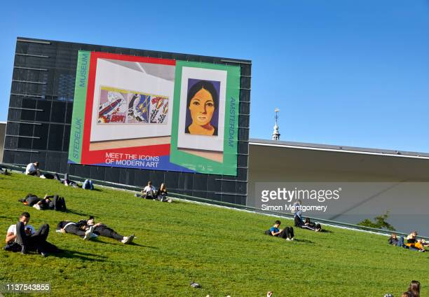 people relaxing on a sunny afternoon on the grass verge outside the stedelijk museum at museumplei - museumplein stock pictures, royalty-free photos & images