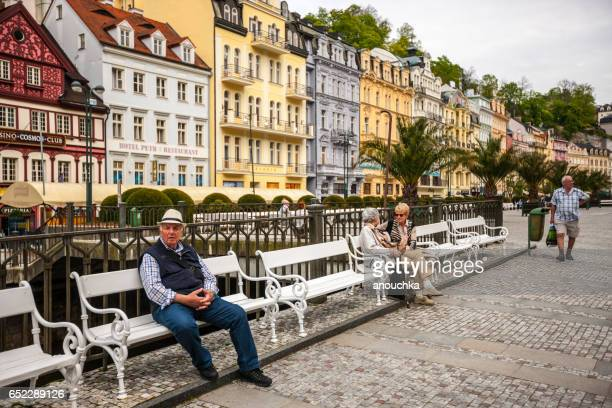 people relaxing on karlovy vary streets, czech republic - karlovy vary stock pictures, royalty-free photos & images