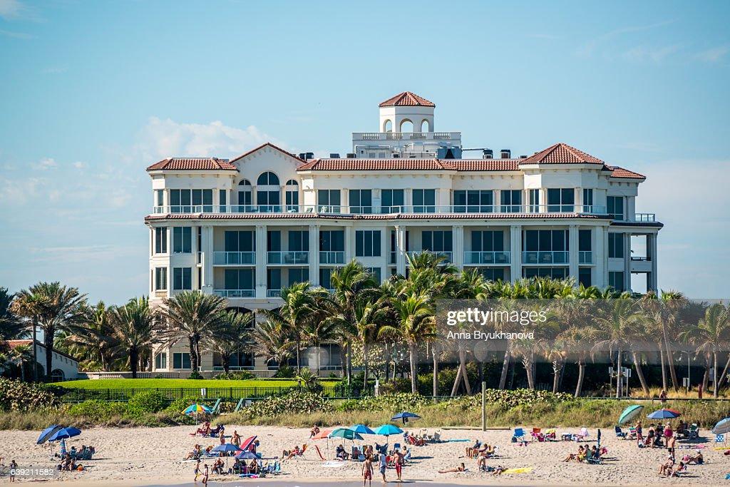 People relaxing on Lake Worth beach, Florida, USA : Stock Photo