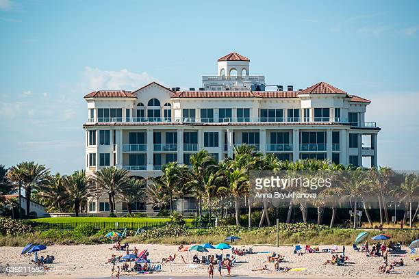 People relaxing on Lake Worth beach, Florida, USA