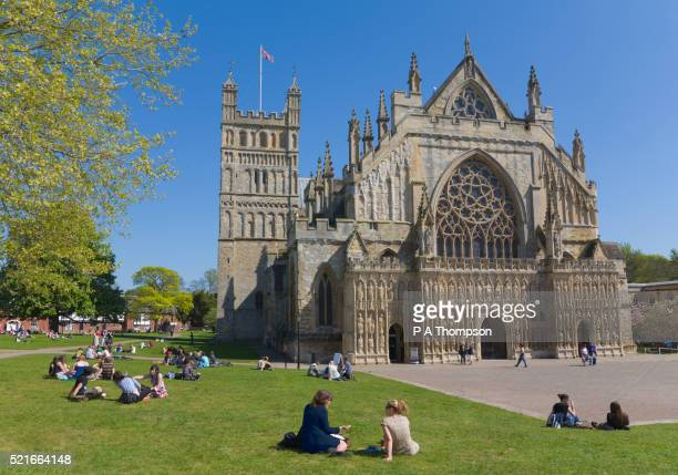 People Relaxing on Lawn of Exeter Cathedral