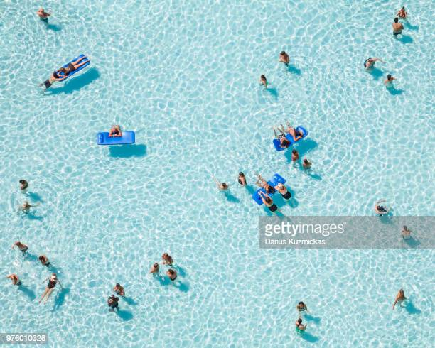 People relaxing on pool, Azure