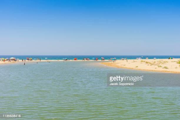 people relaxing on Salgados Beach between Albufeira and Armacao de Pera, Algarve, Portugal