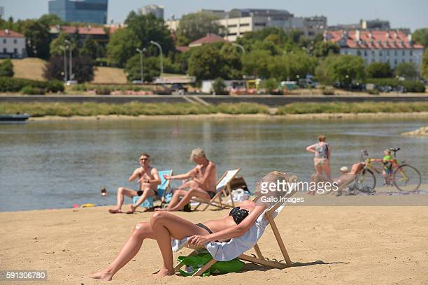 People relaxing on the bank of the Vistula river July 6 2015 in Warsaw Poland