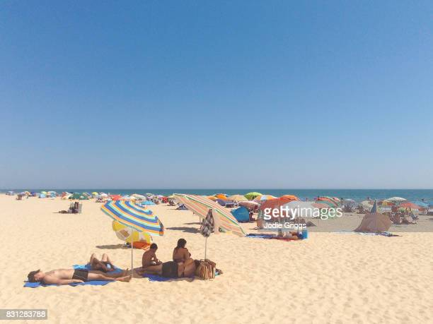 People relaxing on the beach on a hot summer day