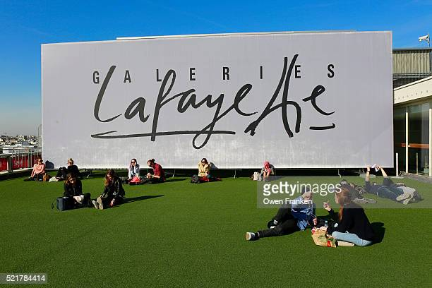 people relaxing on the roof terrace Galeries Lafayette, a department store, Paris