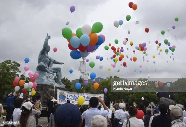 People release balloons at the Nagasaki Peace Park on Sept 20 in the atomicbombed southwestern Japan city of Nagasaki during a signaturecollecting...
