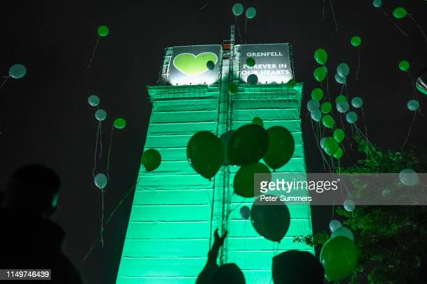 People release balloons in front of Grenfell Tower during a vigil to mark the second anniversary of the fire on June 13 2019 in London England A...