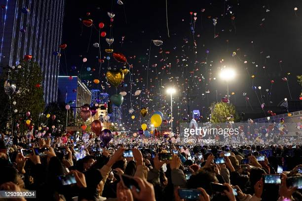 People release balloons into the air to celebrate the new year on January 1st, 2021 in Wuhan, Hubei Province,China.Wuhan With no recorded cases of...