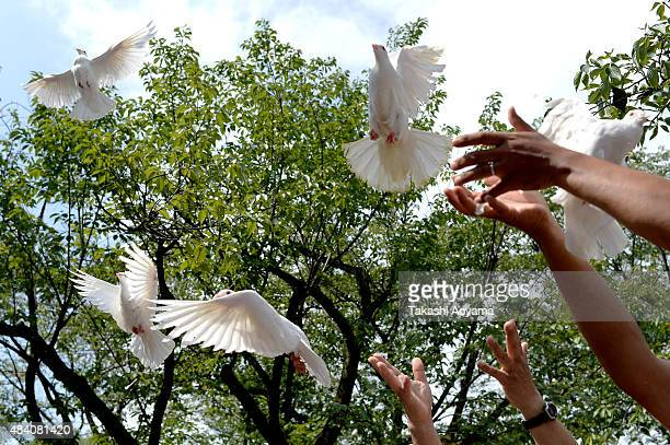 People release doves during a ceremony at the Yasukuni Shrine on August 15 2015 in Tokyo Japan Japan marks the 70th anniversary of the end of World...