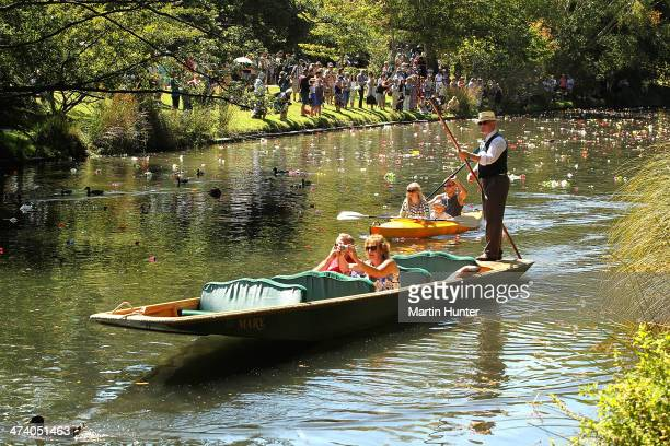 People release flowers into the Avon River as remembrance during a Civic Memorial Service held in the Botanical Gardens for victims of the 2011...