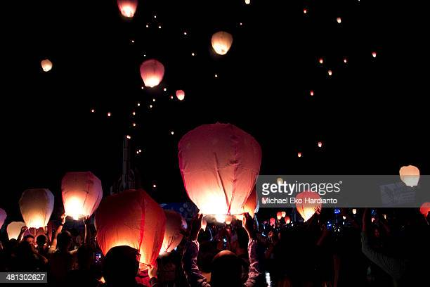 People release lanterns as part of Earth hour celebration on March 29 2014 in Pontianak Indonesia Millions of people across the world in more than...