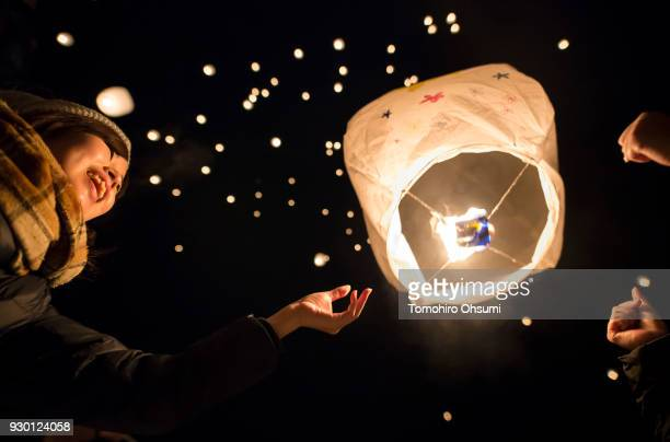 People release paper lanterns into the air during the Tsunan Sky Lantern event on March 10 2018 in Tsunan Japan About 2000 lanterns were released at...