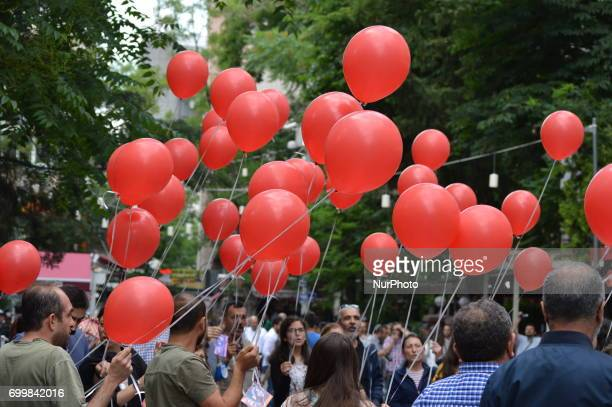 People release red balloons into the sky in support of sacked academic Nuriye Gulmen and primary school teacher Semih Ozakca in Ankara Turkey on June...