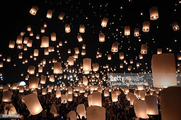 People release thousands of paper lanterns to mark the annual Yi Peng festival in the popular tourist city of Chiang Mai in the north of Thailand on...