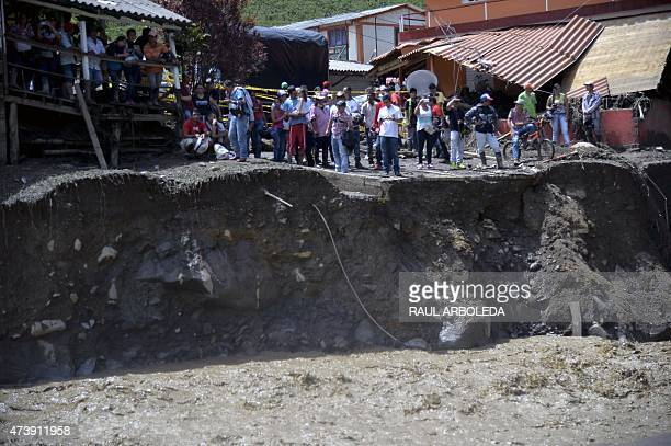 People remain at the area of a landslide in Salgar municipality Antioquia department Colombia on May 18 2015 A massive landslide tore through a...