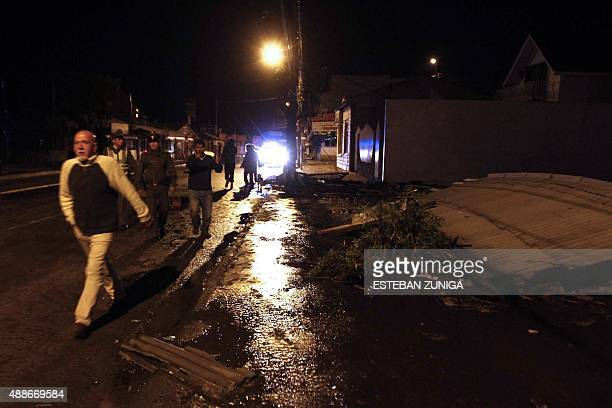 People remain in the street after a strong quake in Concon 110 kms northwest of Santiago on September 16 2015 A massive 83magnitude earthquake struck...