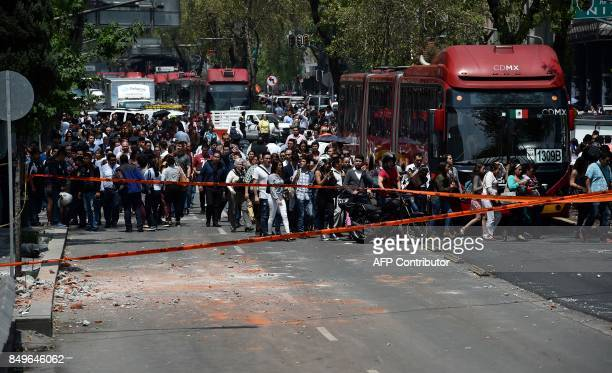 People remain in the streets after a powerful quake rattled Mexico City on September 19 2017 A powerful earthquake shook Mexico City on Tuesday...