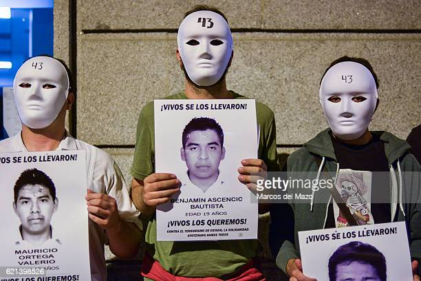 People remembering Ayotzinapa missing students during a vigil in the Mexican Embassy of Madrid.
