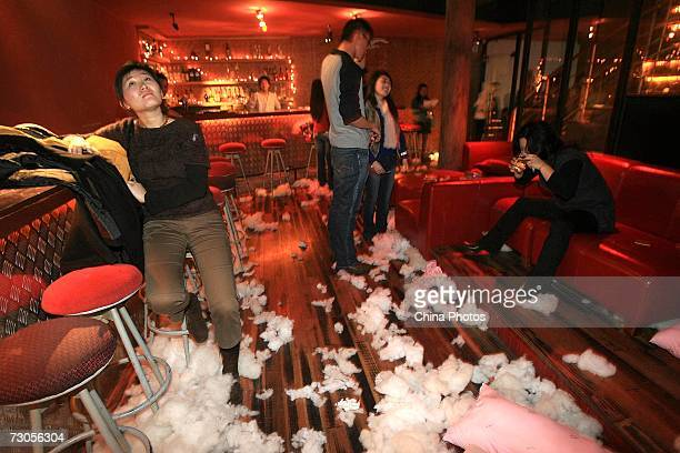 People rest after pillow fight during a 'Pillow Party' at a bar on January 20 2007 in Shanghai China Over 100 Chinese youths attended the party...