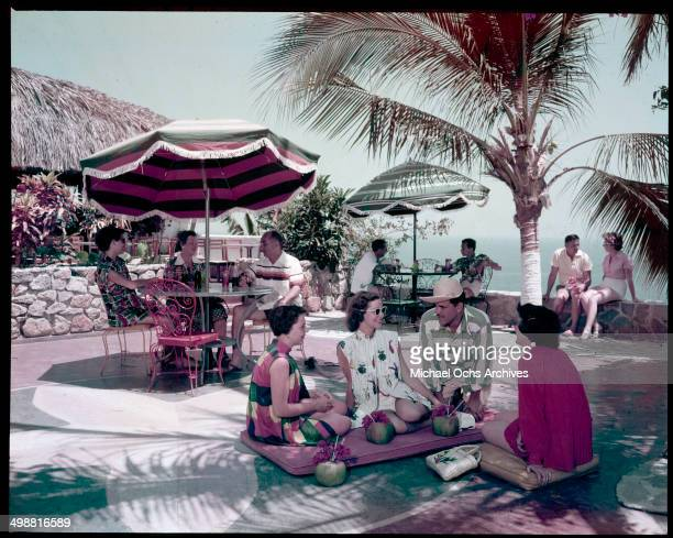 People rest and relax on a patio in Acapulco Mexico in July 1953