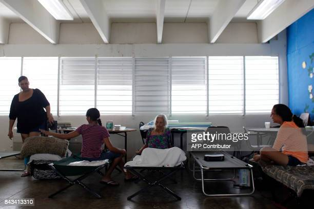 People rest at an emergency center as Hurricane Irma approaches Puerto Rico in Fajardo on September 6 2017 Irma is expected to reach the Virgin...