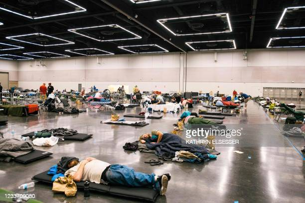 People rest at the Oregon Convention Center cooling station in Oregon, Portland on June 28 as a heatwave moves over much of the United States. -...