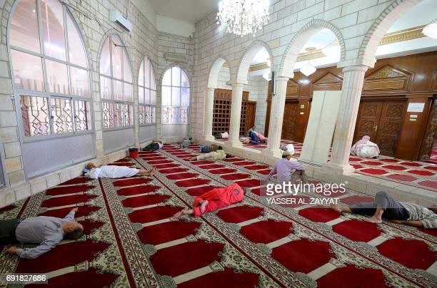 People rest in a mosque in Kuwait City on June 3 during the holy Muslim month of Ramadan Ramadan is sacred to Muslims because it is during that month...
