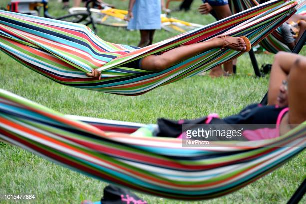 People rest in hammocks as residents community members and locals enjoy a popup beach in North Philadelphia when thousands of pedestrians cyclist...