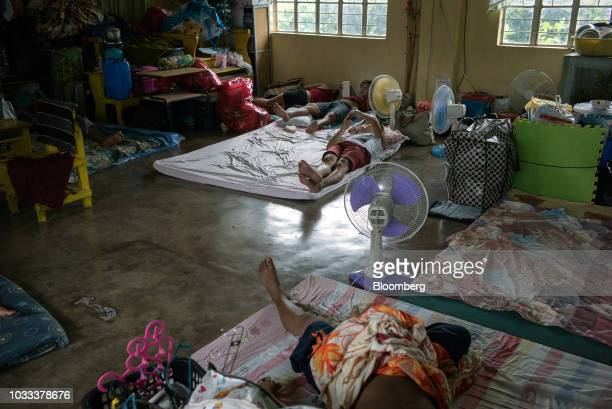 People rest inside a temporary evacuation center at Balzain East Elementary School ahead of Typhoon Mangkhut's arrival in Tuguegarao Cagayan province...