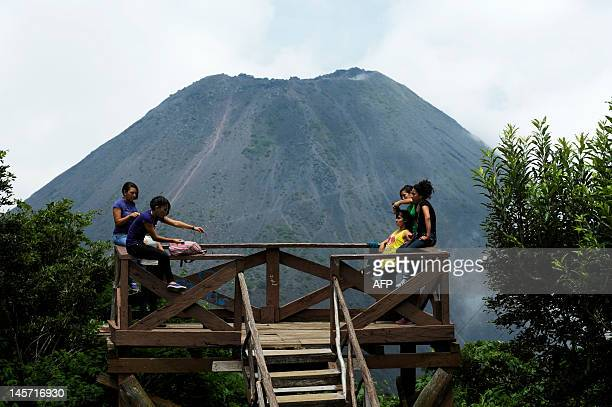 People rest on a mirador facing the Izalco volcano in the Volcanoes National Park in Izalco 59 km west of San Salvador on June 3 2012 World...