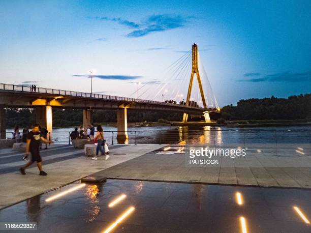 people resting and having a walk on vistula river boulevard in warsaw, poland - warsaw stock pictures, royalty-free photos & images