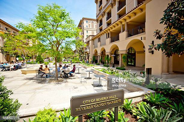 people resting at beverly canon gardens - beverly hills california stock pictures, royalty-free photos & images