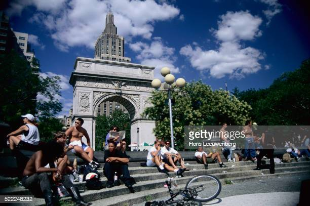 People Resting on Steps of Washington Arch