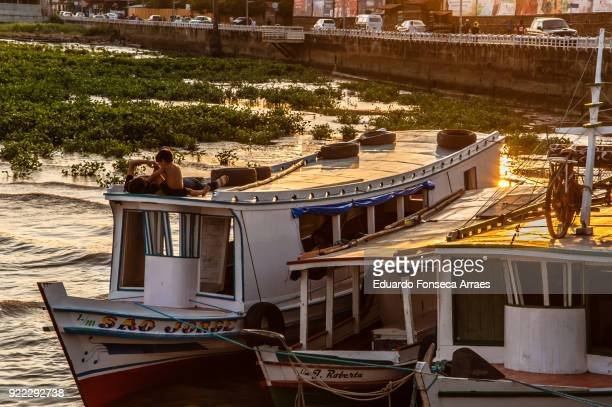 people resting on their boats - amapá state stock pictures, royalty-free photos & images
