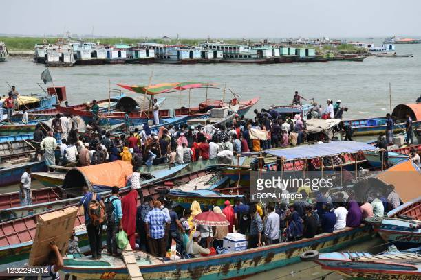 People return home by boat before lockdown at Mawa Ferry terminal near Dhaka. Bangladesh extends nationwide lockdown measures until April 25 and...
