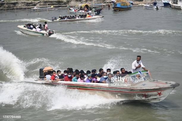 People return home from Dhaka by speed boat before lockdown at Mawa Ferry terminal near Dhaka. Bangladesh extends nationwide lockdown measures until...