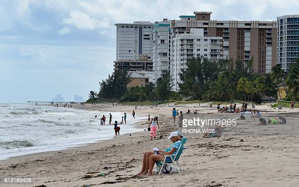 People return to the beach at Pompano Beach Florida on October 07 after Hurricane Matthew brushed the southeast coast of Florida Hurricane Matthew...