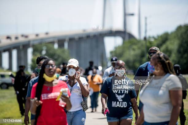 People return to their vehicles after gathering to honor the life of Ahmaud Arbery at Sidney Lanier Park on May 9, 2020 in Brunswick, Georgia. Arbery...