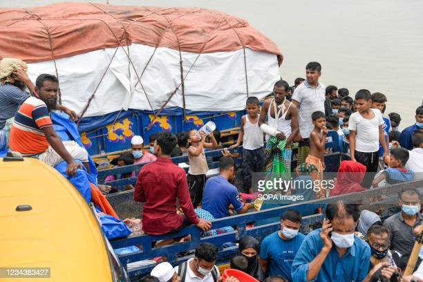 People return to their work areas in Dhaka after government relaxed the lockdown restrictions. Thousands of Bangladeshi garment workers returned to...