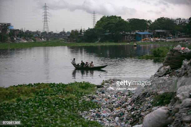 People ride a boat on the Buriganga river June 10 2018 in Dhaka Bangladesh Bangladesh has been reportedly ranked 10th out of the top 20 plastic...