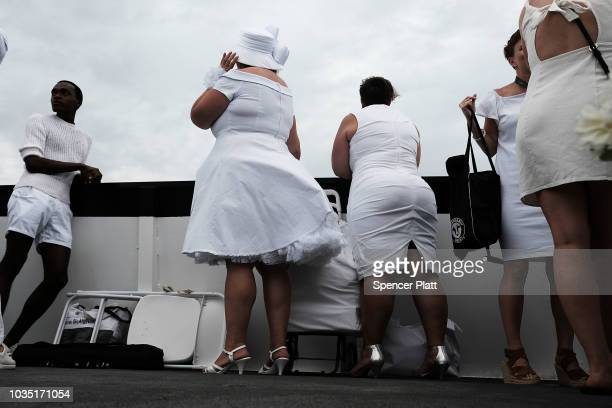 People ride a ferry to enjoy dinner at the annual 'Diner en Blanc' September 17 2018 on Governor's Island in New York City Diner en Blanc began in...