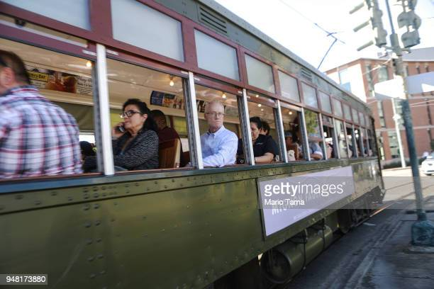 People ride a historic streetcar on April 17 2018 in New Orleans Louisiana New Orleans originally founded by the French in 1718 is celebrating its...