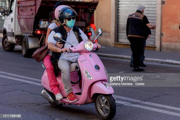 People ride a pink Vespa downtown during coronavirus emergency on May 04, 2020 in Rome, Italy. Italy was the first country to impose a nationwide...