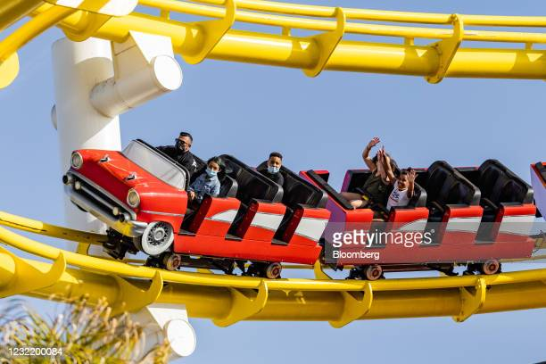 People ride a roller coaster at Pacific Park on Santa Monica Pier in Los Angeles, California, U.S. On Thursday, April 8, 2021. California officials...