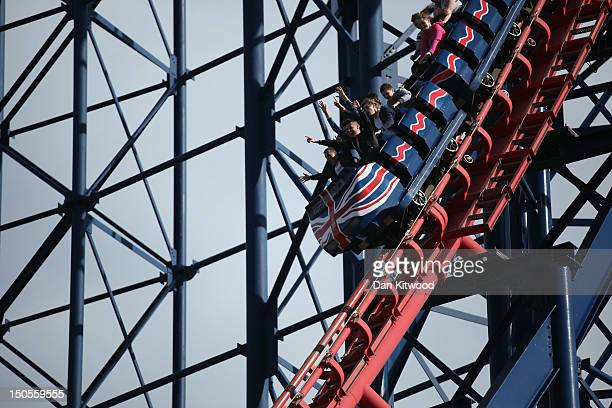 People ride a Rollercoaster at Blackpool Pleasure Beach on August 21 2012 in Blackpool England