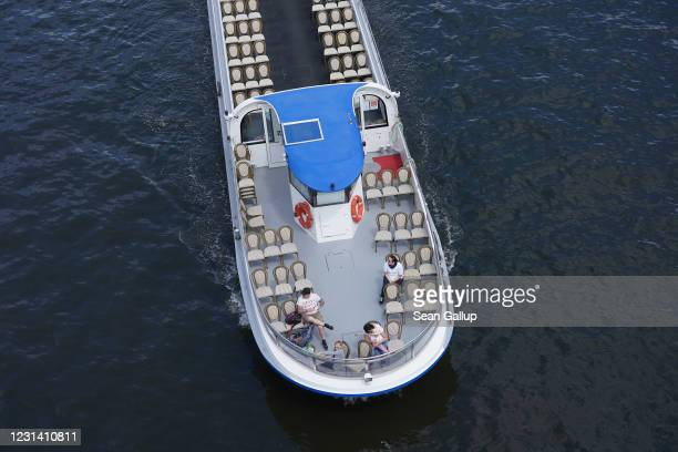 People ride a sparsely occupied tourist boat on the Spree River during the coronavirus crisis on May 29 2020 in Berlin Germany While lockdown...