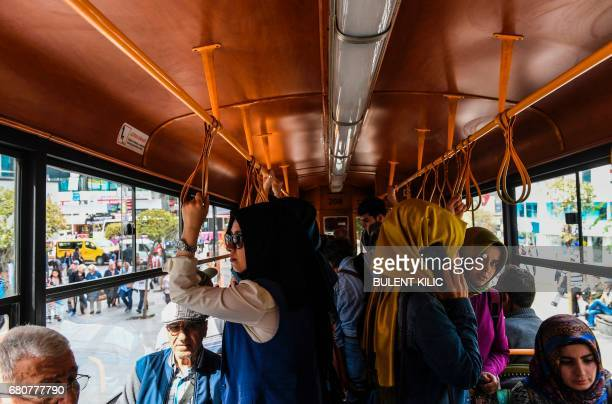 People ride a tram in Istanbul's Kadikoy district on May 9 2017 / AFP PHOTO / BULENT KILIC
